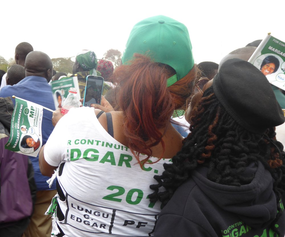 PF supporters posing for a selfie during a political rally in Woodlands stadium, Lusaka Photo: Wendy Willems