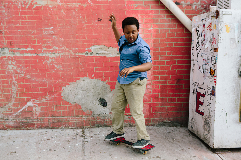 From The Atlantic: Justin, 14, plays on his skateboard as he waits for his brothers to bring out an after-school snack from the corner bodega in Brooklyn on May 20, 2015. Cassandra Giraldo