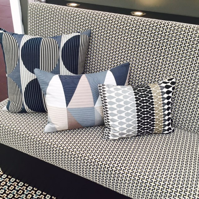 Mix geometric patterns. They all look good as long as you have a common colour theme and various sizes