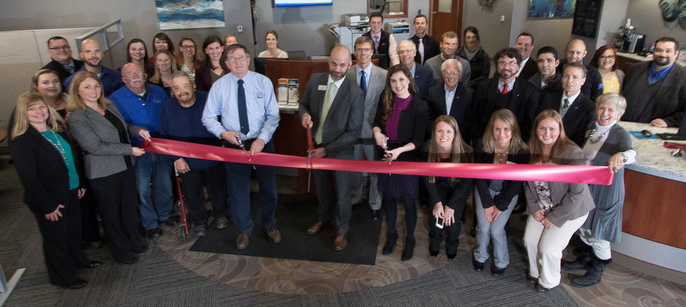 KCCU staff and board members, as well as members of Southwest Michigan First, and AVB Inc. attending the Kellogg Community Credit Union Ribbon Cutting at the new branch located at 1650 South Drake Road in Kalamazoo, in the Corner@Drake development.