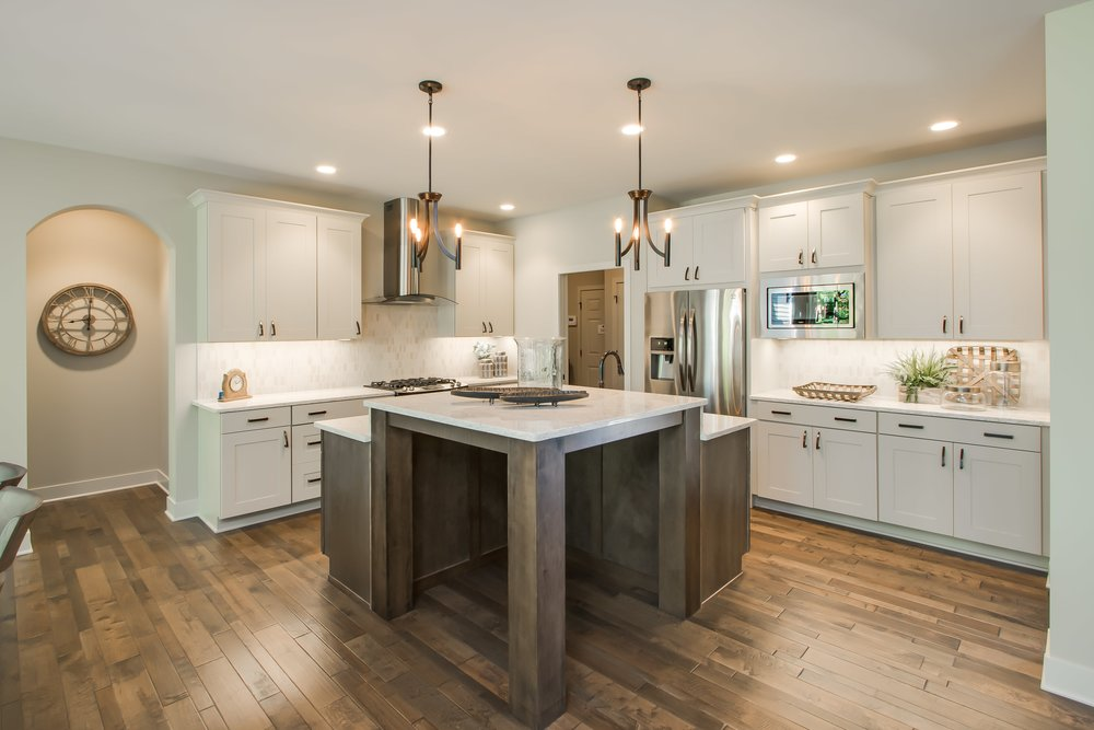6_15_2017_WW_03_59_Lily_Kitchen_Full View of hardwood floors, white cabinets, and island-min.JPG