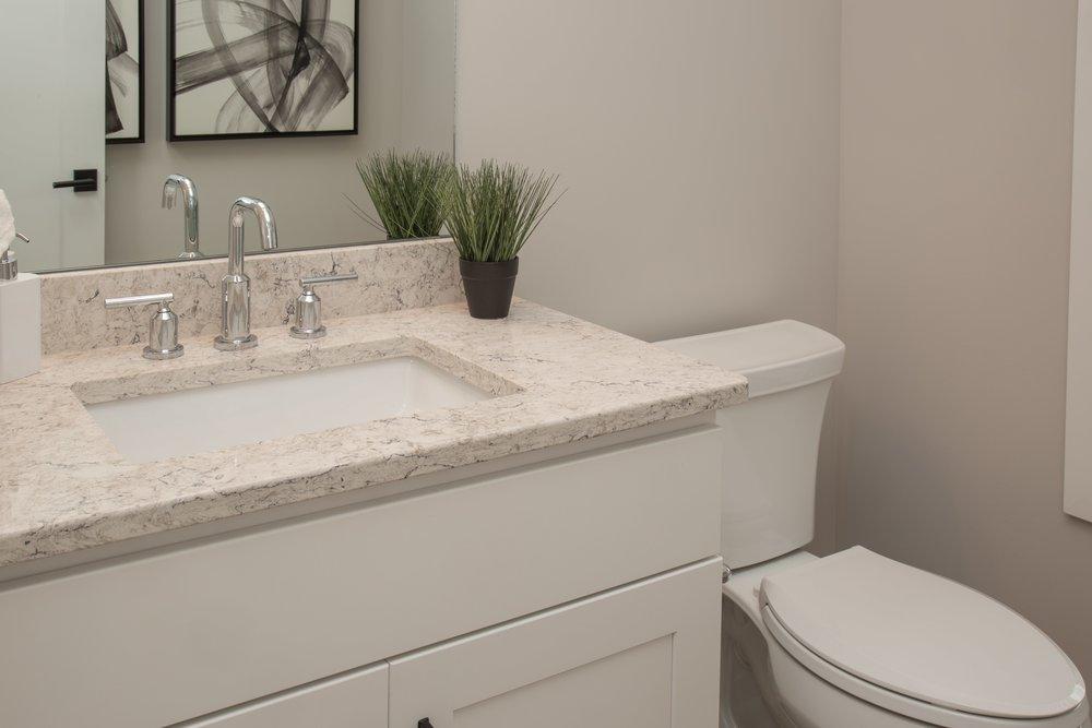 6 25 2018 TW-01-23-Anthracite_Powder Bath_White Cabinets_Quartz-min.JPG