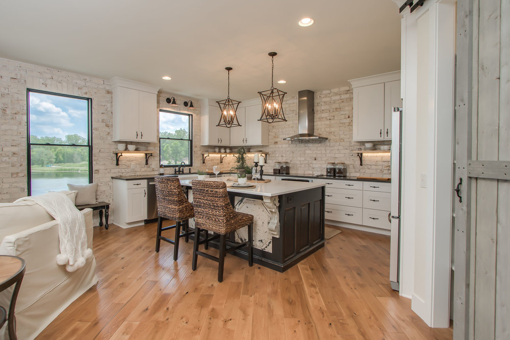 6_15_2017_Cus_16_089_Kitchen_Hardwood floors_dark wood island and white perimeter.JPG