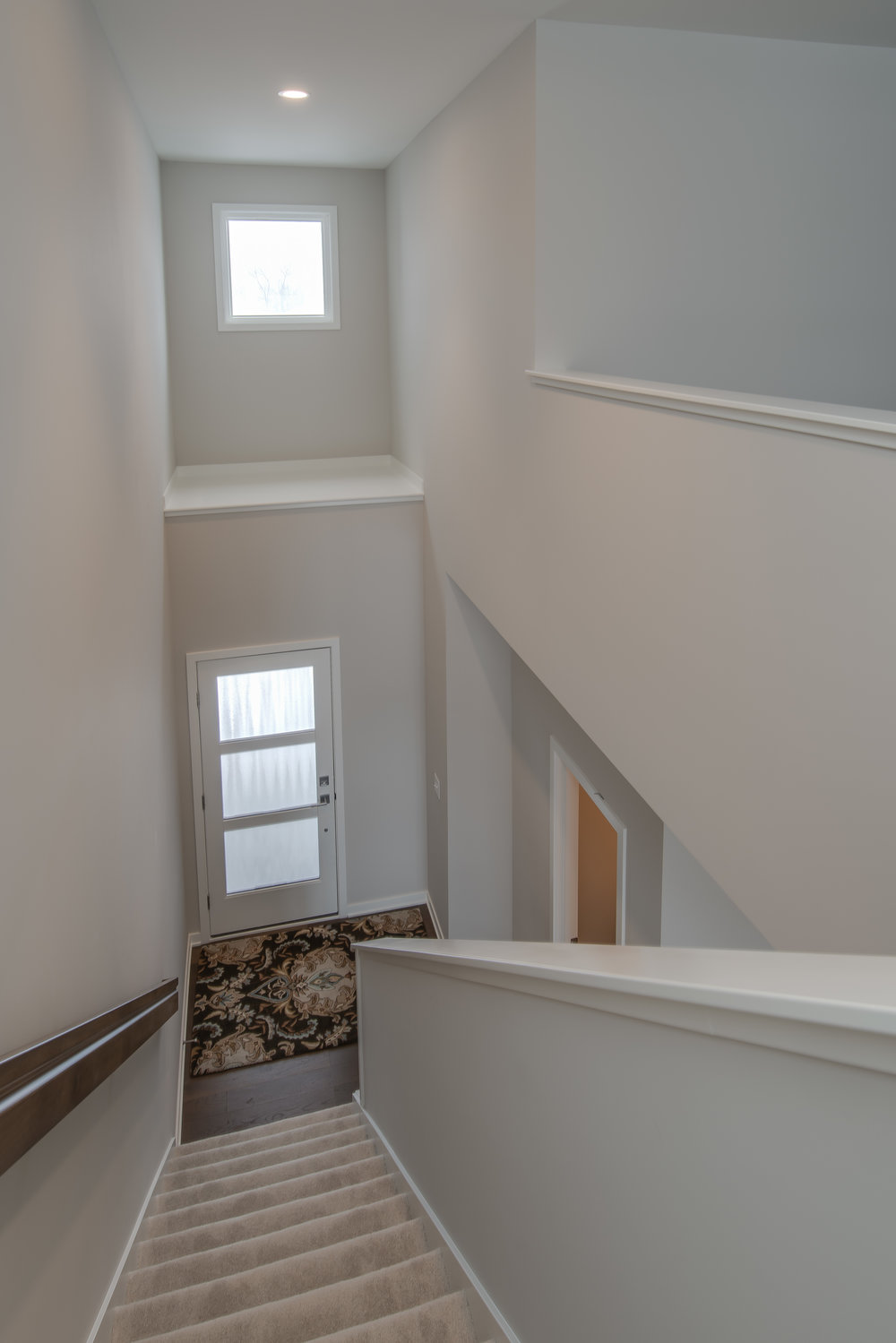 Stairway lighting and entry statement