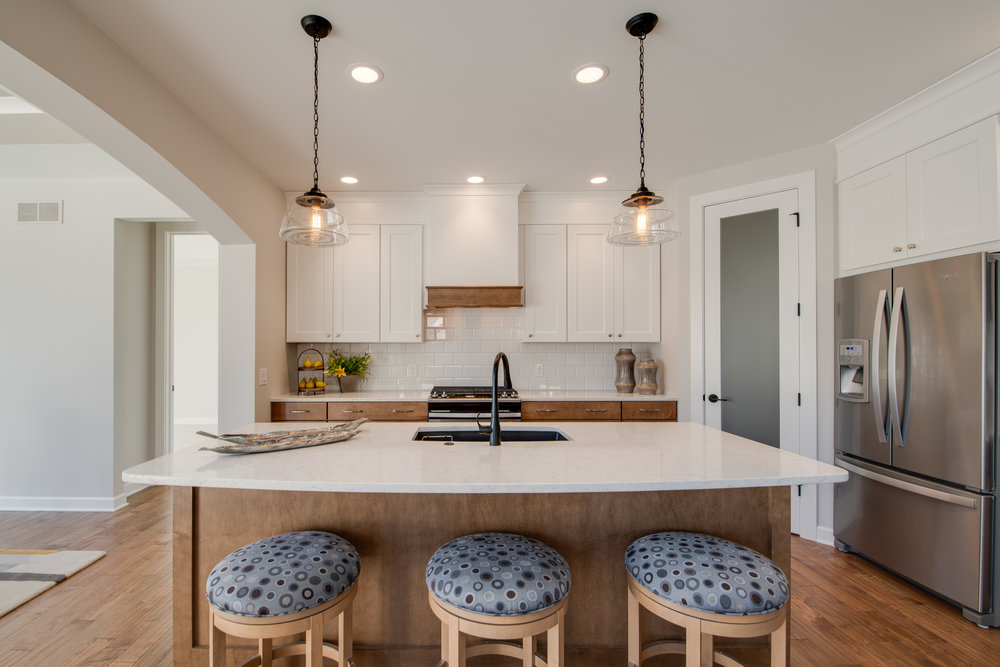 Kitchen island is perfect for housing bar stools