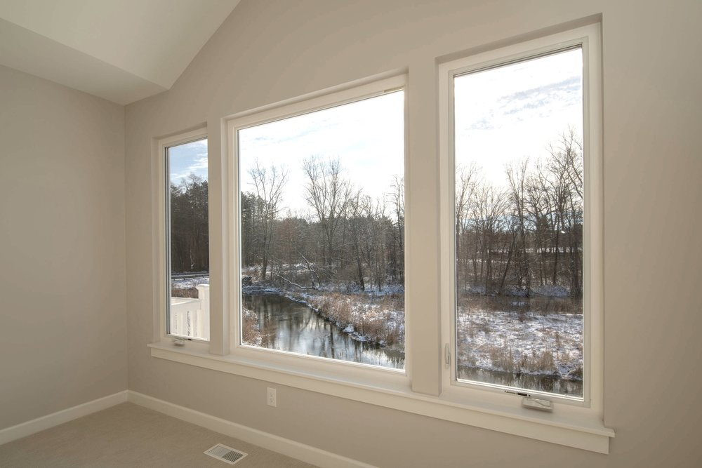 Large windows look out to the Portage Creek and wooded areas