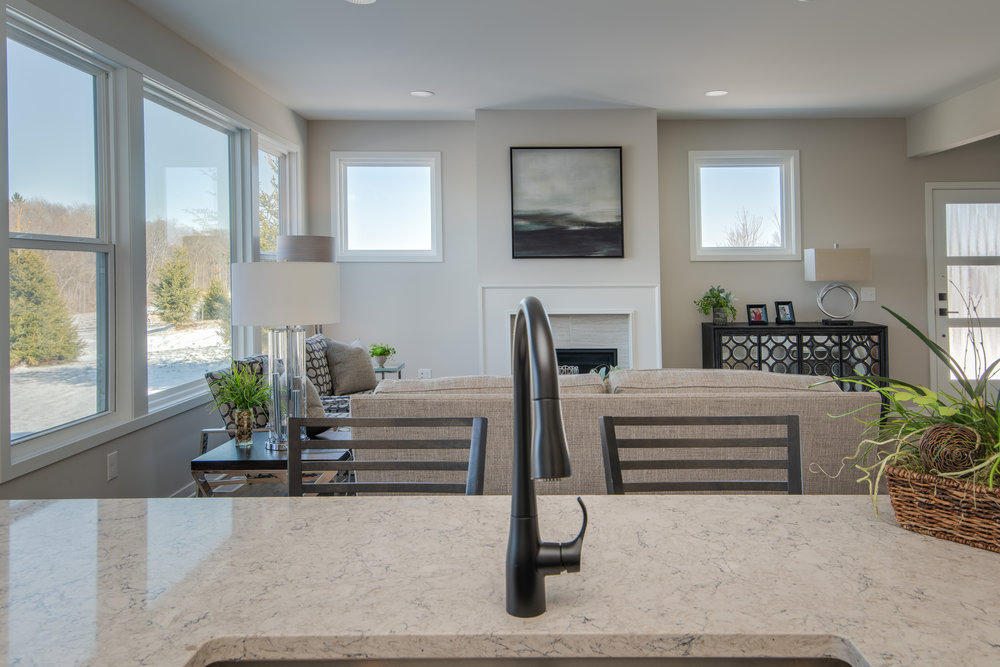 The open concept floor plan allows the kitchen to open up into the main living area