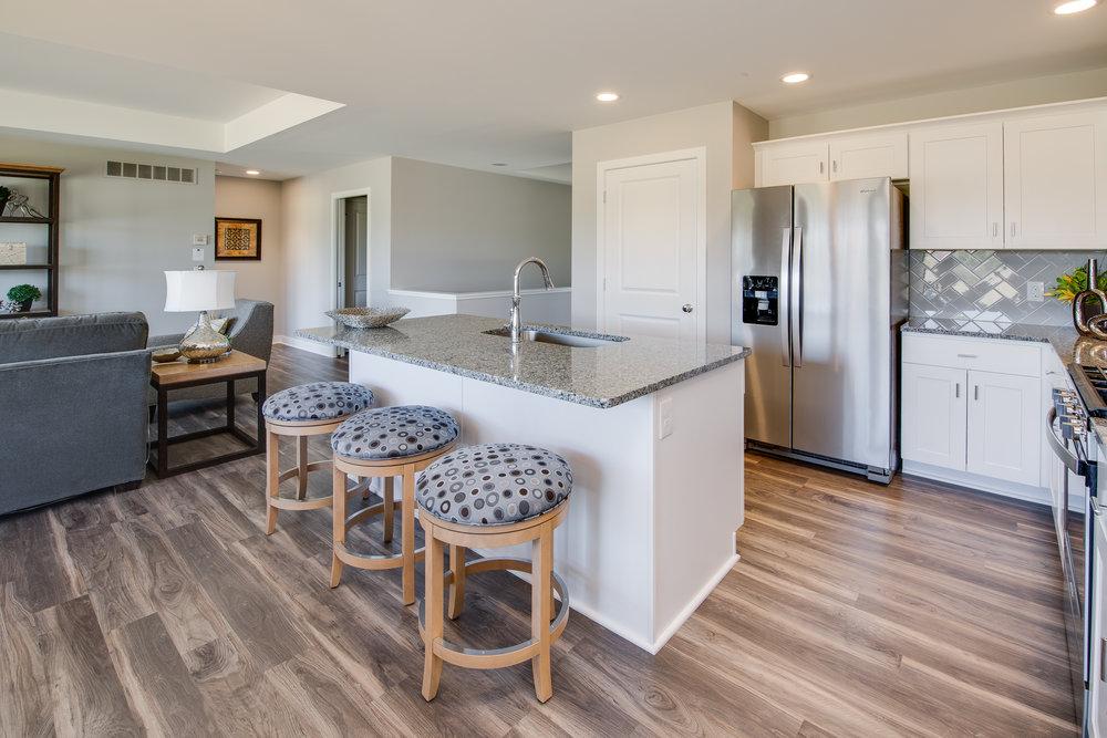 5 1 2018 AC-01-28-Bluebell_Kitchen_Island_Granite_White Cabinets.JPG