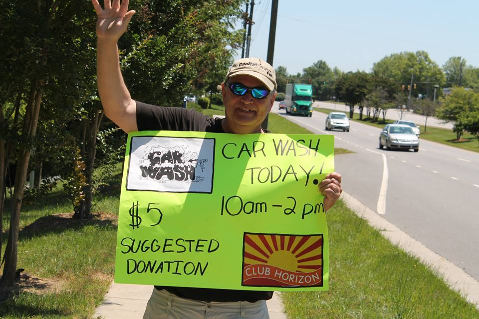 Member with Car Wash Sign.jpg