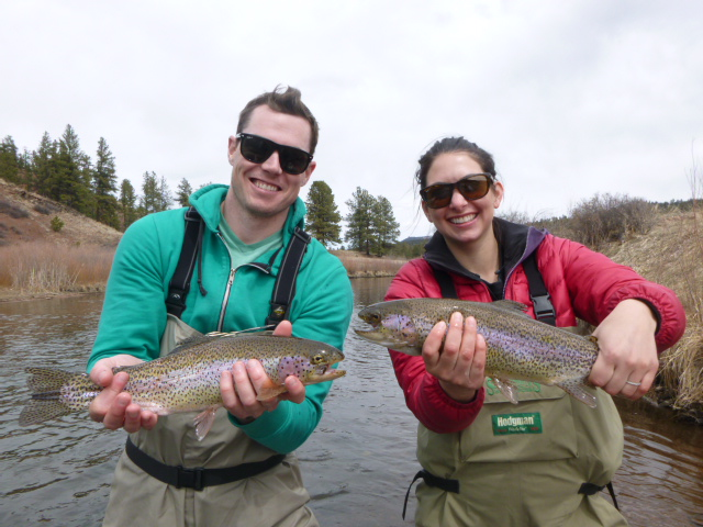 Happy clients with 2 Rainbow Trout caught on the South Platte