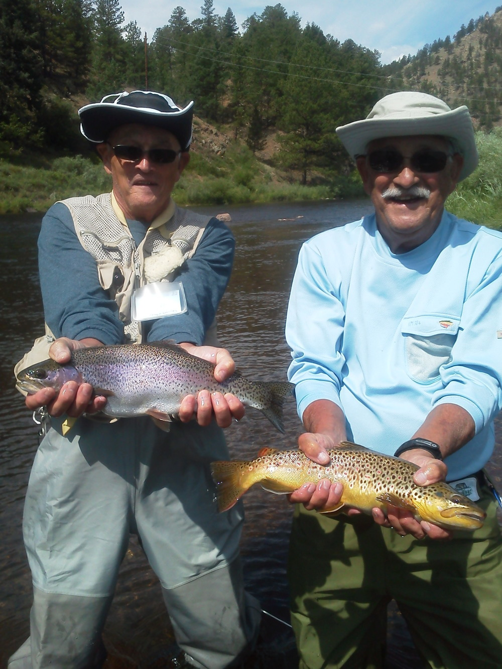 Happy clients with a Rainbow and Brown Trout