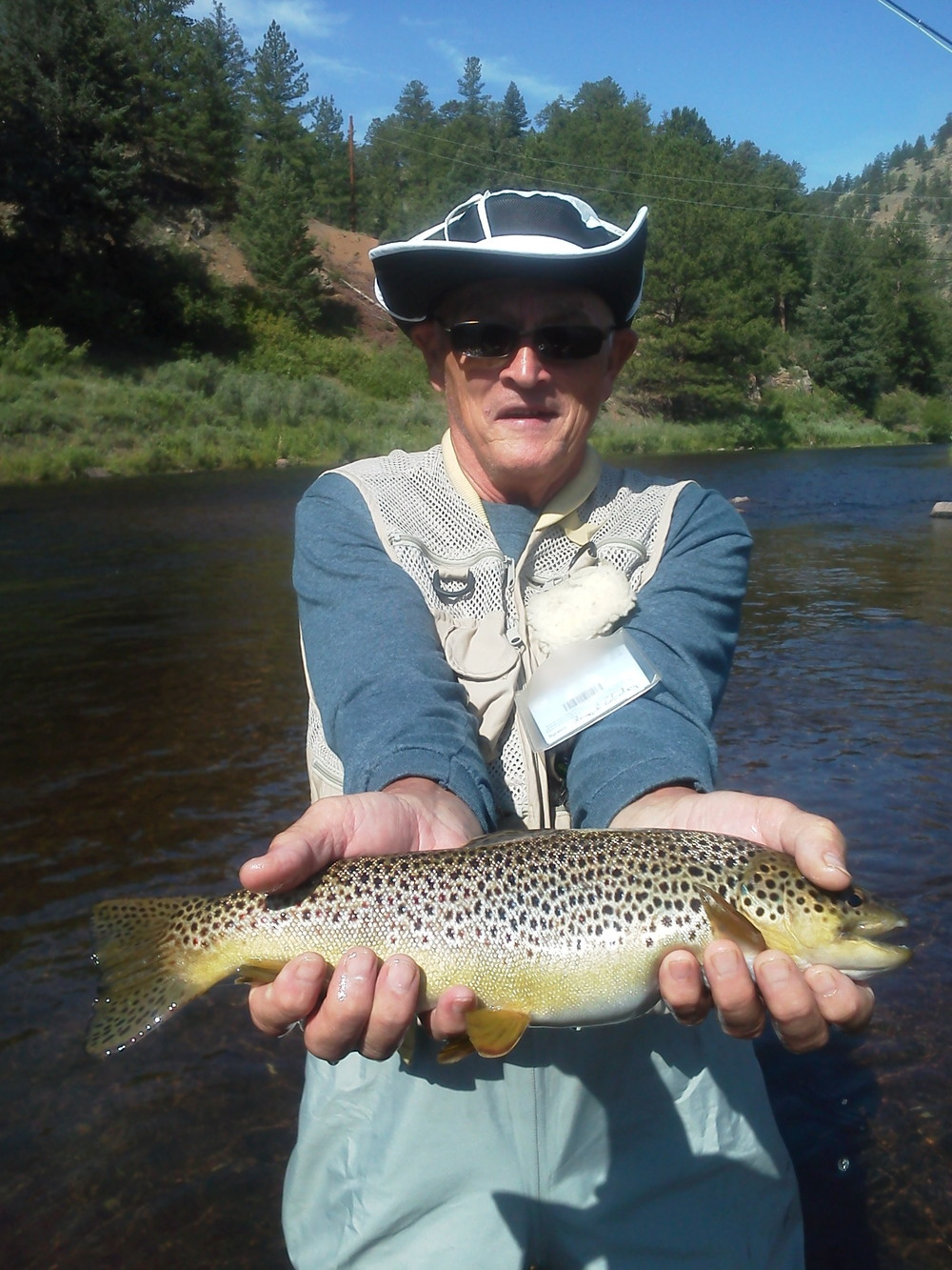 Happy client with a Brown Trout caught on the South Platte