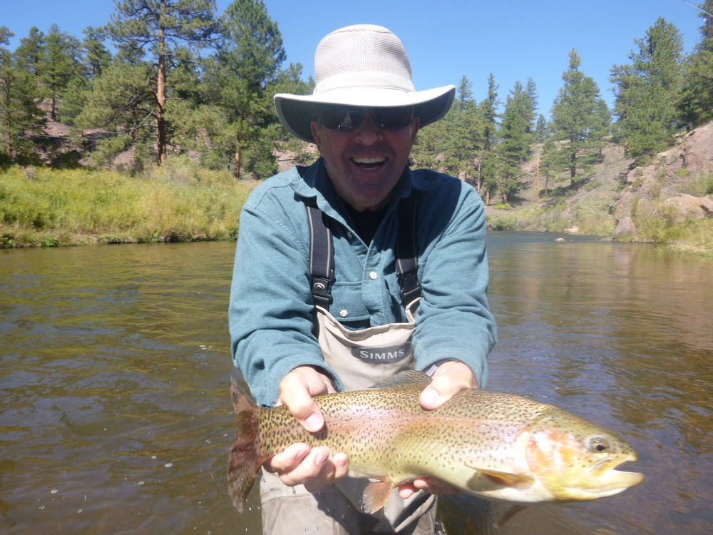 A very happy client with a nice Rainbow Trout