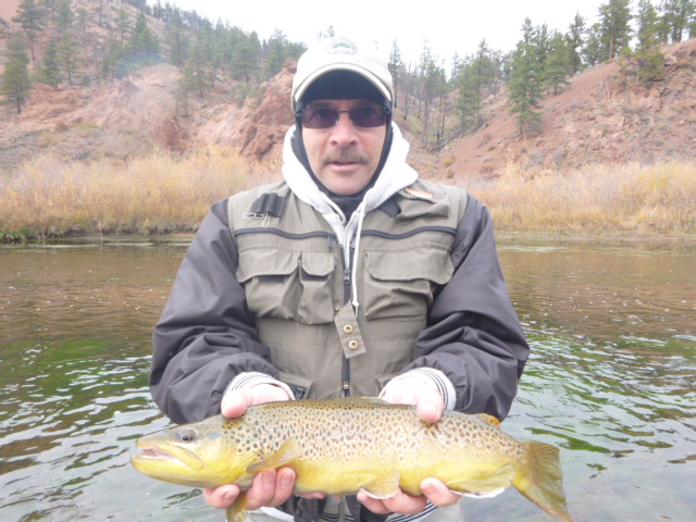 A very happy client with a nice Brown Trout