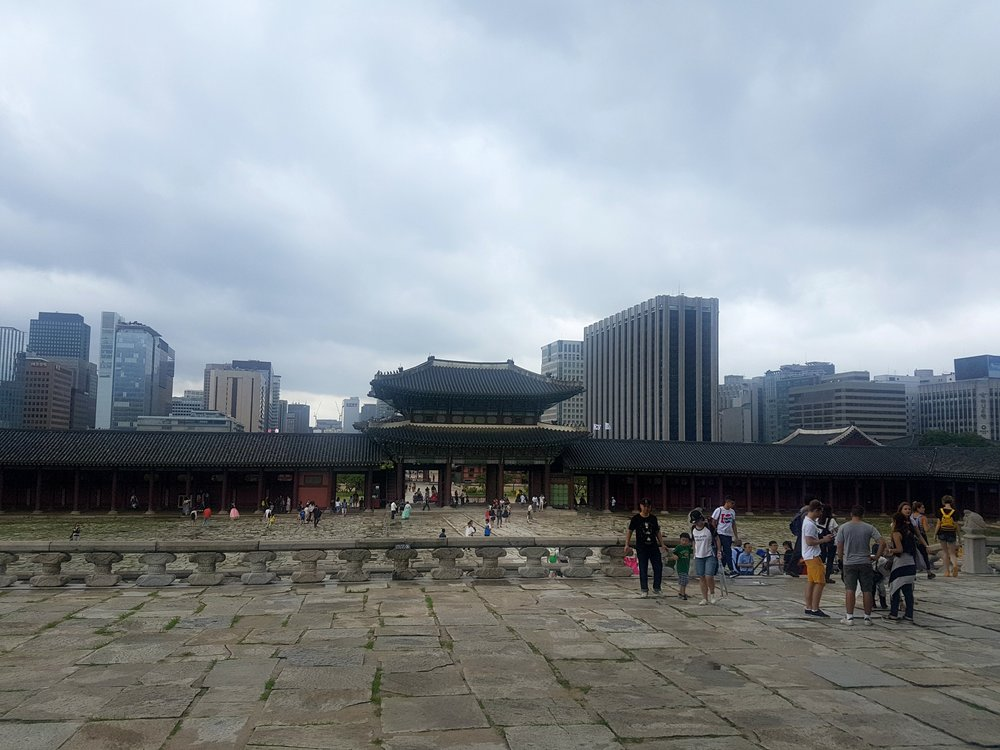 The old and the new, right next to each other. The temple area is located in between the mountains and the city.