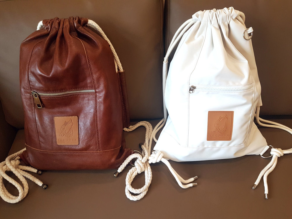 The leather prototype on the left next to the final canvas product on the right.