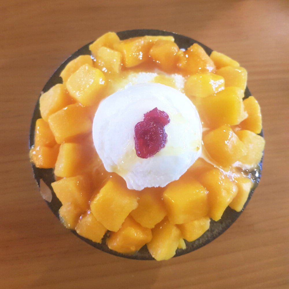 Ice flakes is a popular dessert - this one was served with some mango and ice cream on top.