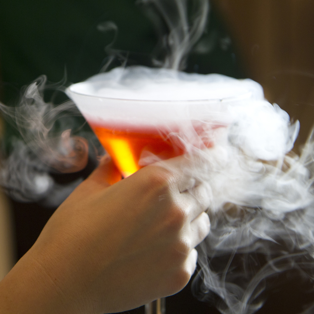 "A guest with a ""smoking"" cosmo. It takes 1-2 minutes for the smoke to disappear."