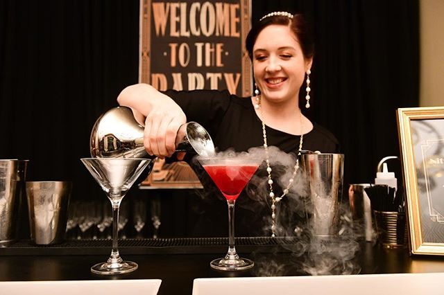 MetroNational's holiday party was not a standard corporate affair. The guests had a ball at this lavish Speakeasy-themed event that included impeccably chosen 1930's style decor details. Our Nitro Cocktail Bar provided a perfect blend of vintage flair plus modern drink recipes.⠀ •⠀ •⠀ •⠀ @Daniel4000 captured the guests dressing the part with plenty of fringe, pearls, feathered headbands, and pinstripe suits. We love joining the fun and getting into character to fit the look of the event!⠀ •⠀ •⠀ Venue: @ZaZaHouston⠀ Photographer: @Daniel4000⠀ Company: #MetroNational⠀ #smokingcocktails #nitrobar #cocktailgram #speakeasy #nitrodrinks #uniquedrinks #propertymanagement #houstoncatering #nitrogencocktail #cocktailbar #houstonbarservice