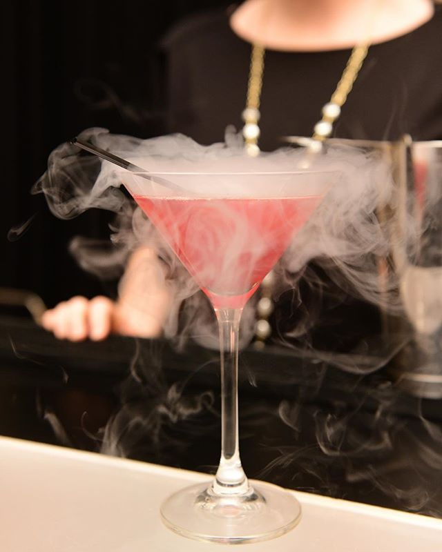 This is our alluring Pomegranate Cosmo smoking cocktail. With its captivating red color, it combines #SkyVodka, @POMWonderful, and Cointreau for this drink that is not too sweet and is so appealing!⠀ •⠀ •⠀ •⠀ The music for this evening did not disappoint, with the DJ spinning a brilliant concoction of modern day tunes combined with the old songs and sounds from the 20s. Needless to say this impressive combination got the crowd! •⠀ •⠀ Venue: @ZaZaHouston⠀ Photographer: @Daniel4000⠀ Company: #MetroNational⠀ #smokingcocktails #nitrobar #cocktailgram #speakeasy #nitrodrinks #uniquedrinks #propertymanagement #houstoncatering #nitrogencocktail #cocktailbar #houstonbarservice #cocktailoftheday