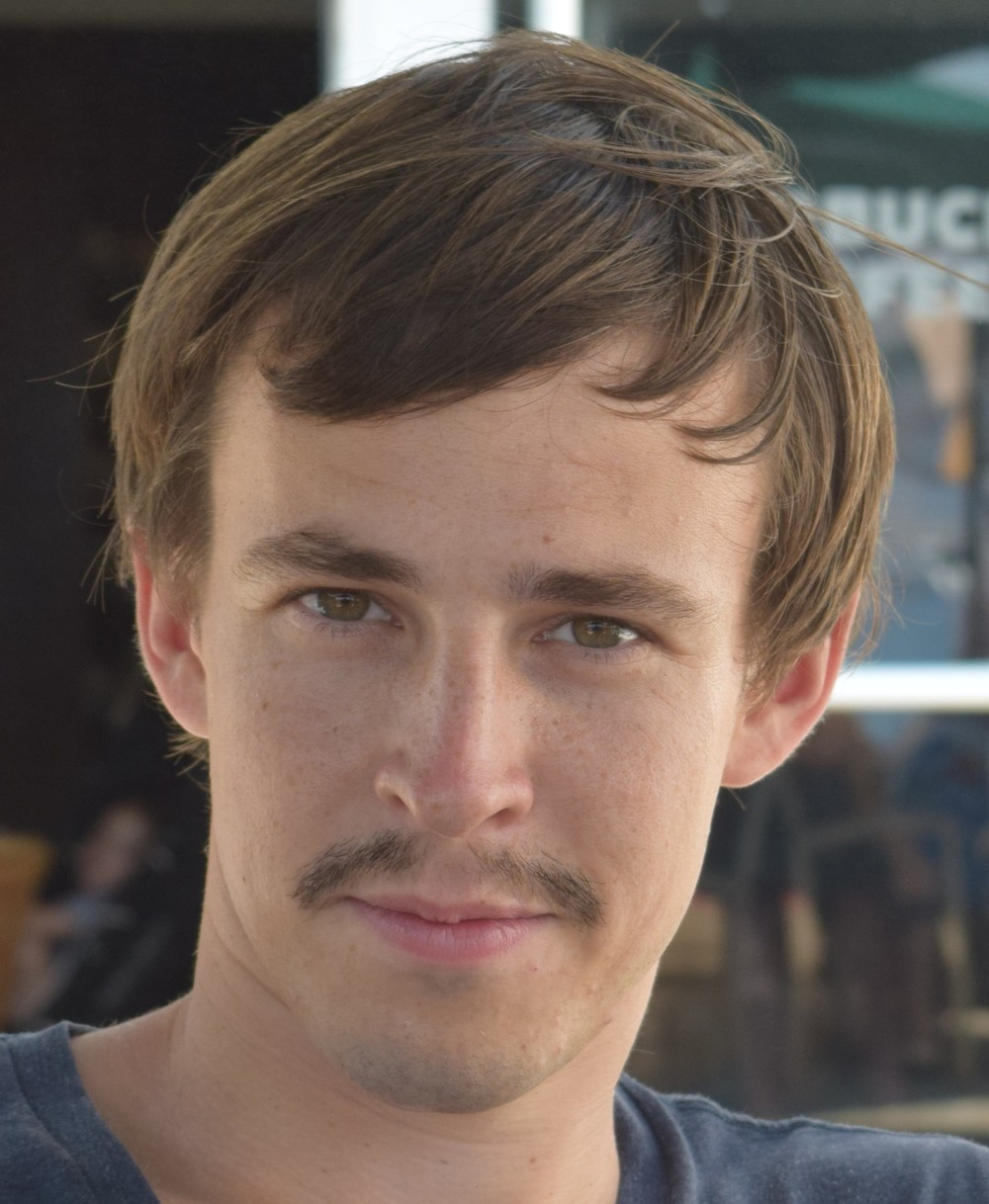The mustache when it was just a wee lad.  [Feel free to forward this head shot to your talent agent friends.]