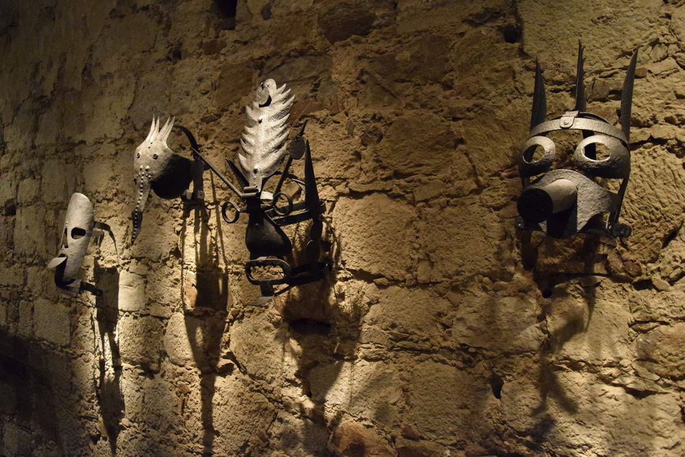 Masks from the castle's exhibition on the barbarism of torture