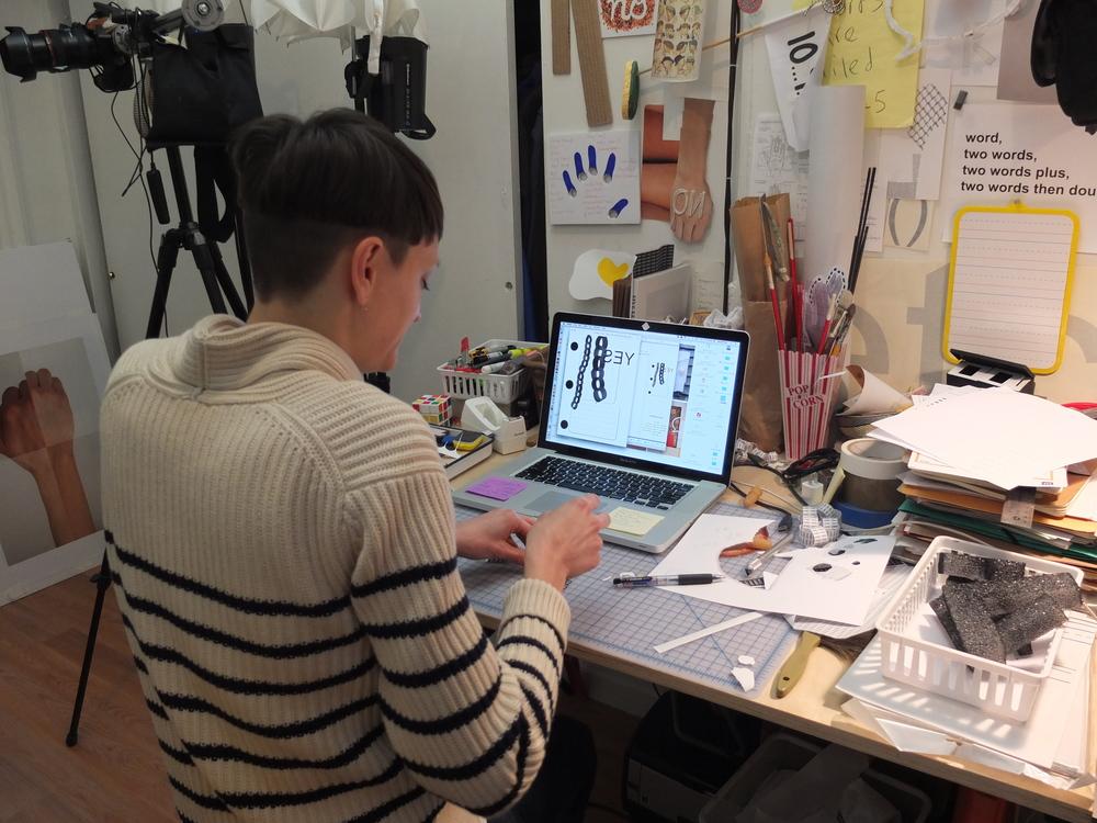 Jennifer working at her desk