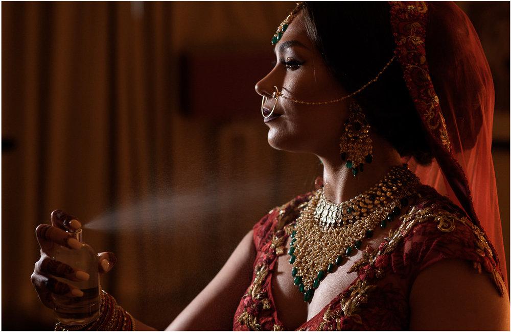 Indian bride spraying perfume