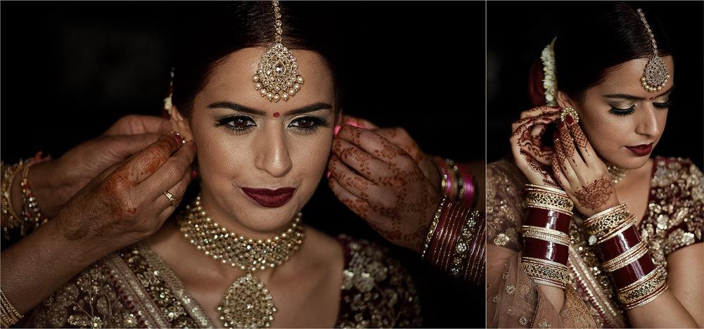 Sikh bride putting on her earrings