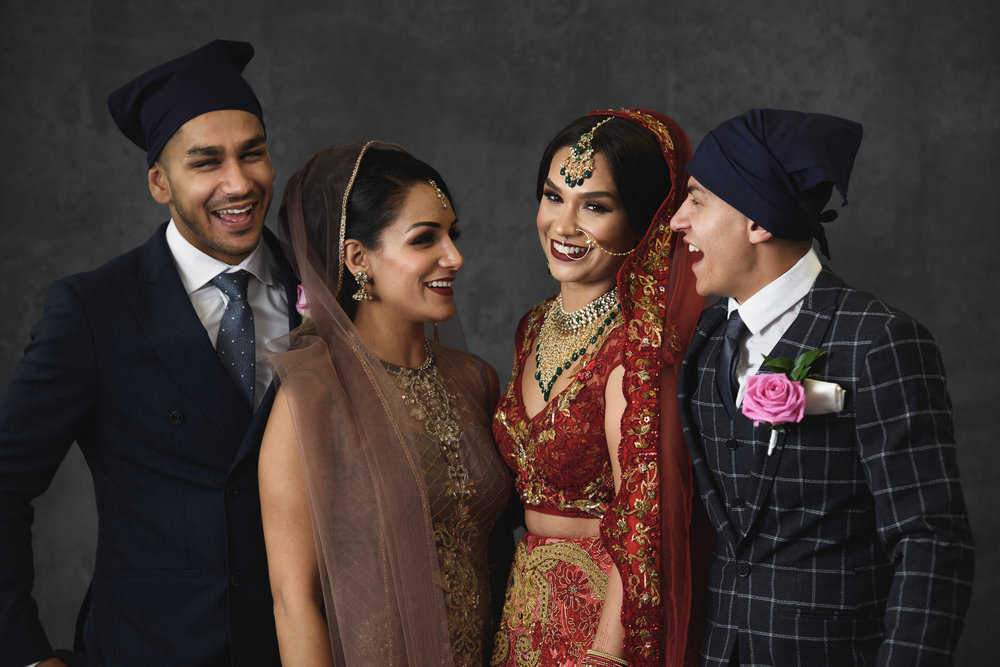 Sikh bride with her family laughing