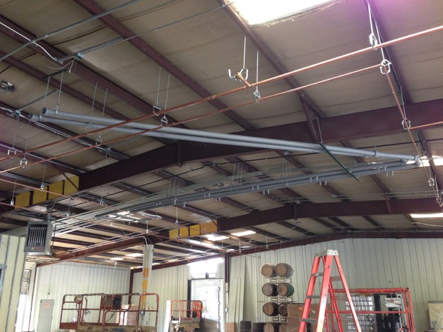 Installation of overhead water and glycol piping
