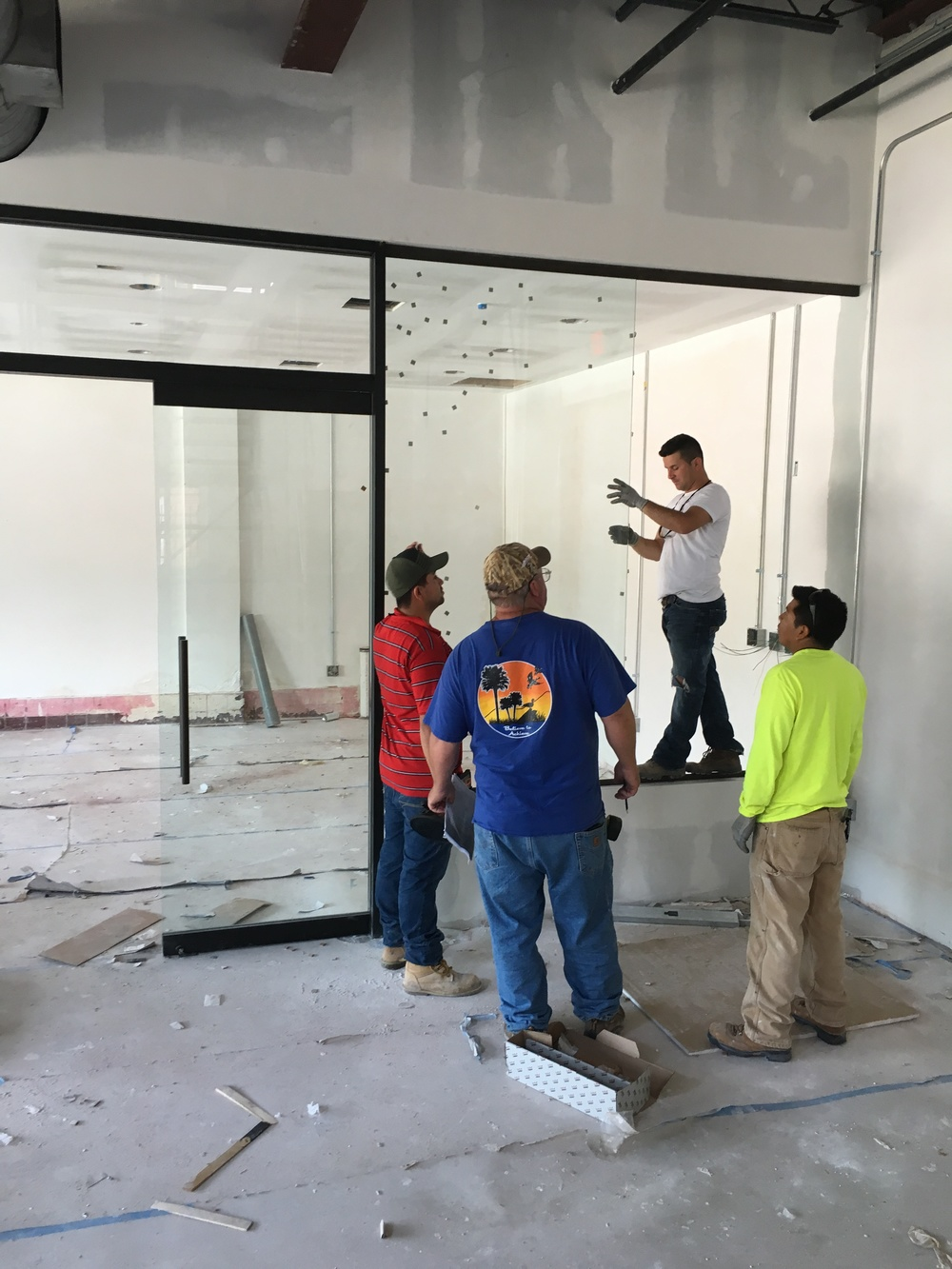 Glass panel insertion at new conference room on first floor