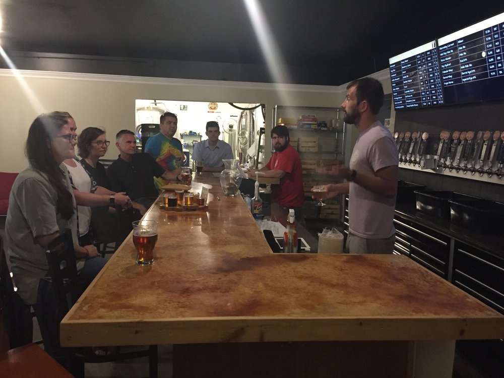 Team members from Empire Properties and Maurer Architecture get schooled in the art of beer