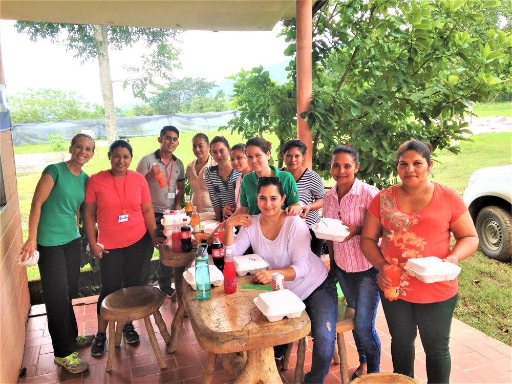 Team of women at Coagricsal in Honduras who de-shells whole beans for Harmony snacking cacao.