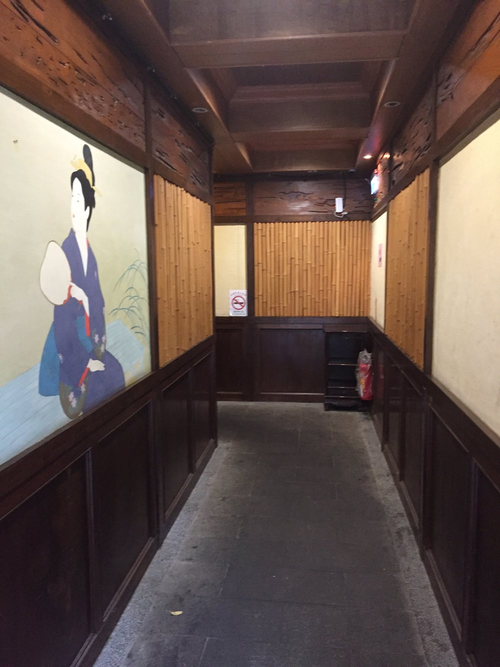 Hallway to private rooms with Japanese-style decor