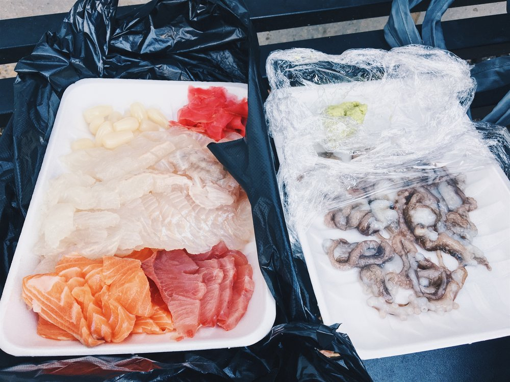 Fresh sashimi and octopus from Noryangjin Market. Yes, the octopus still moves after it is cut up!