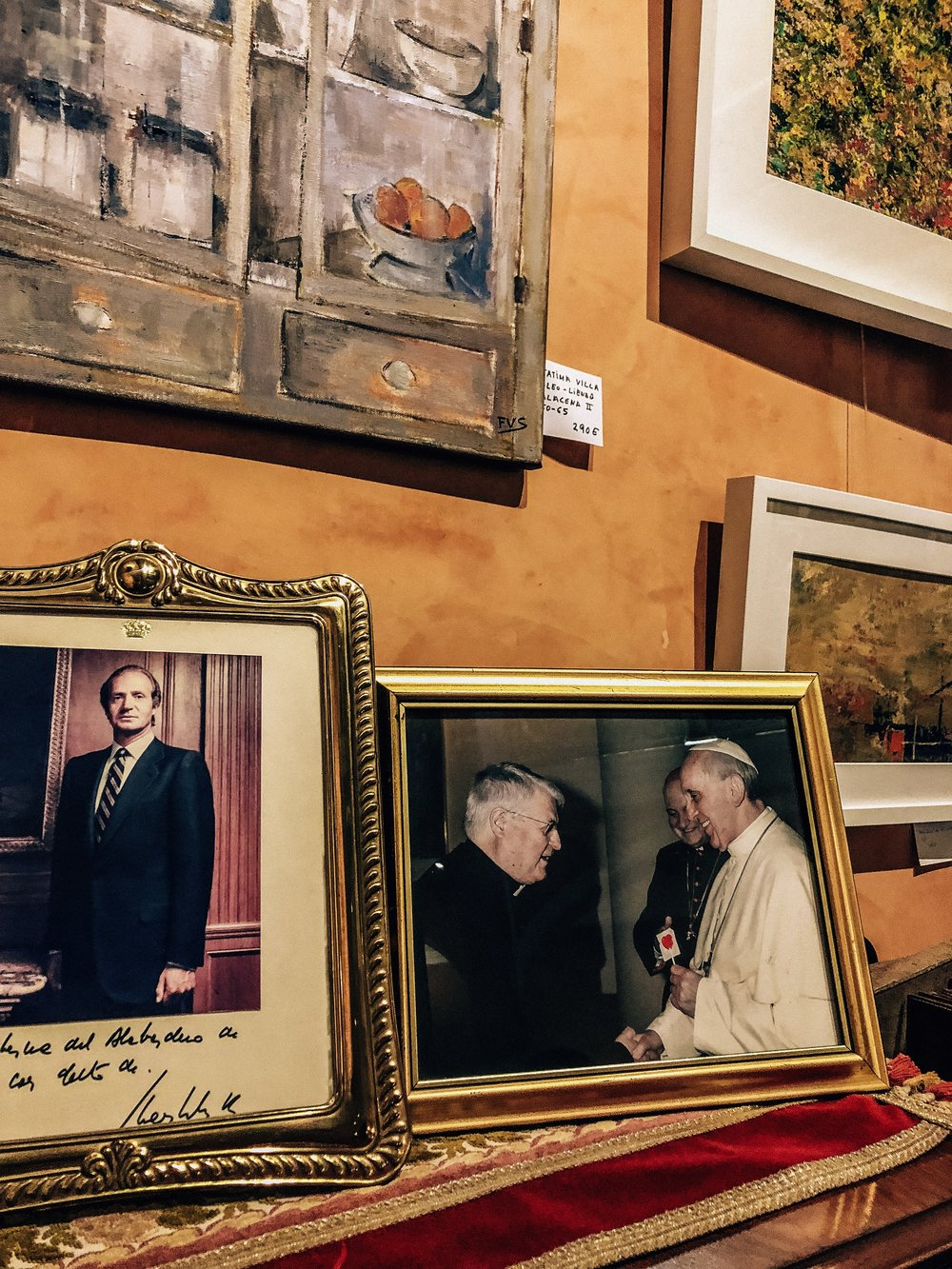 Homey decor at Taberna Alabardero with a photo of the Pope holding a lollipop.