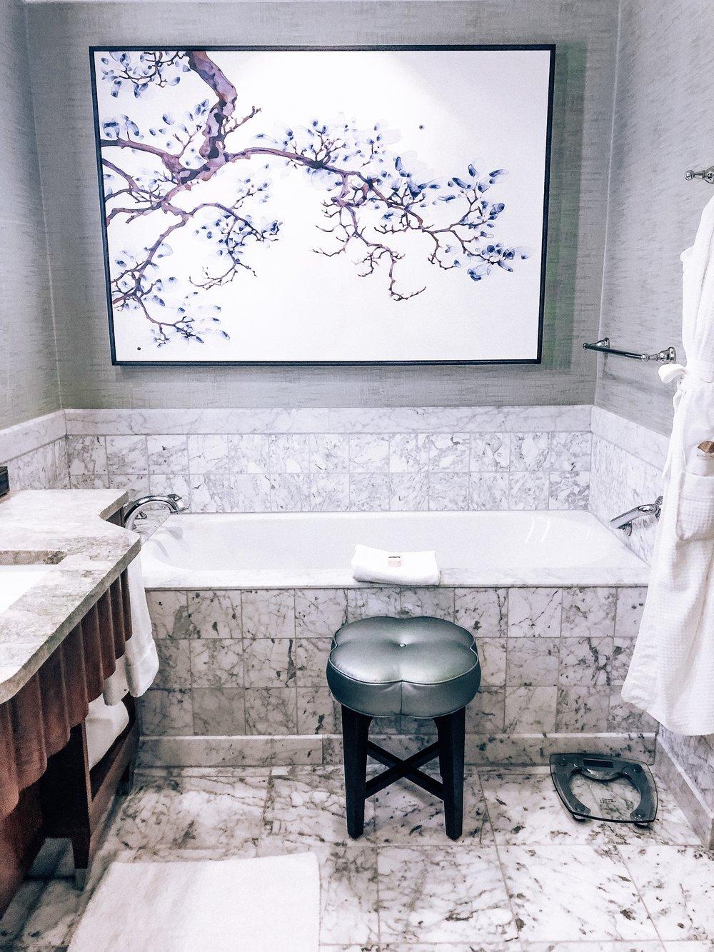 Marbled bathroom and tub