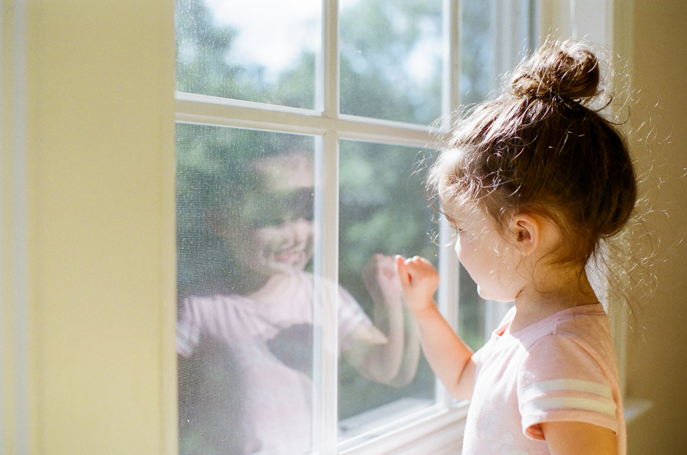 little girl at window | DC family and film photographer | Yasmina Cowan Photography