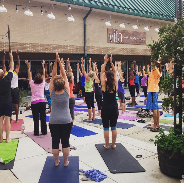 One of many yoga classes hosted outside of VITA's doors on the square.