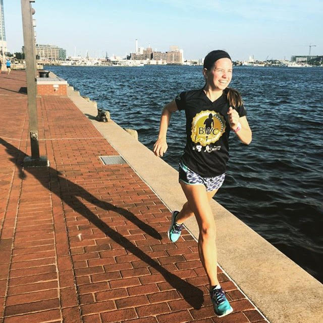 Katie runs around the Inner Harbor during a fun run from the Baltimore store