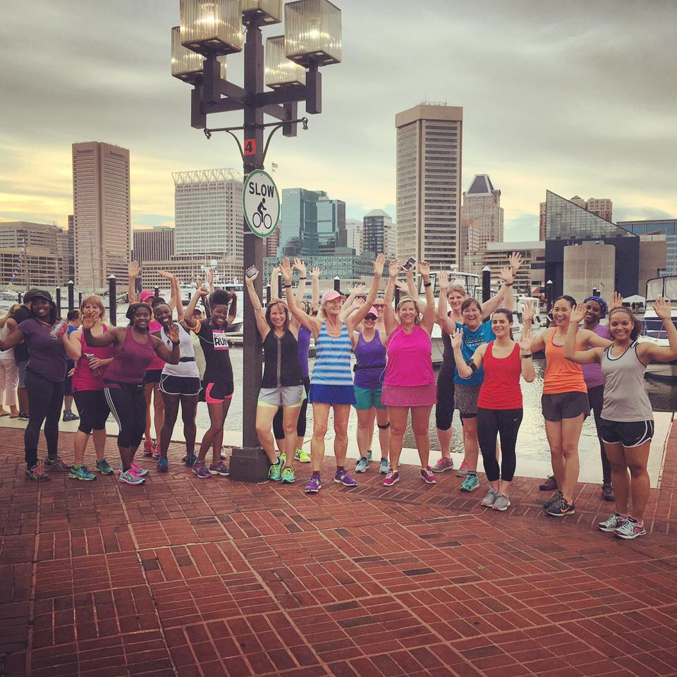 A group training for the Baltimore Women's Classic meets for a run around the Inner Harbor.