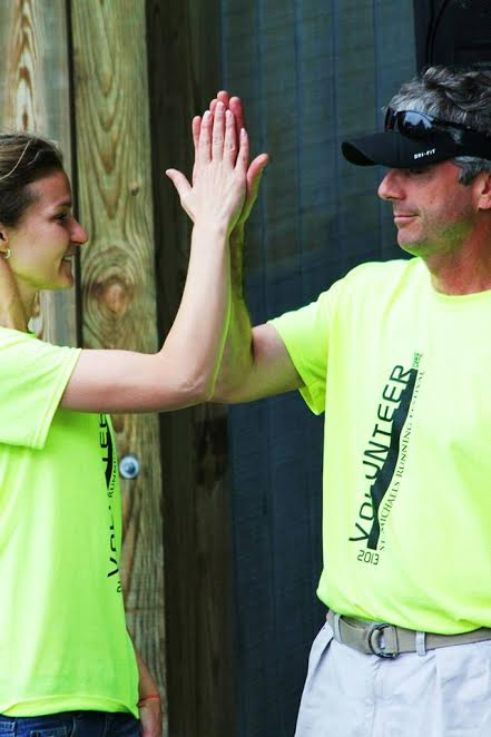 Sparrow high fives Across the Bay 10K co-founder, Peter Paris.