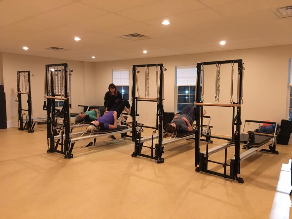 Some of our runners try out a pilates reformer class.