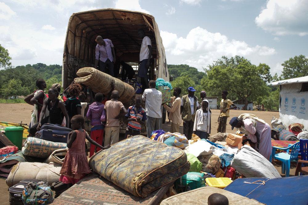 5- Unloading at Maaji Settlement.jpg