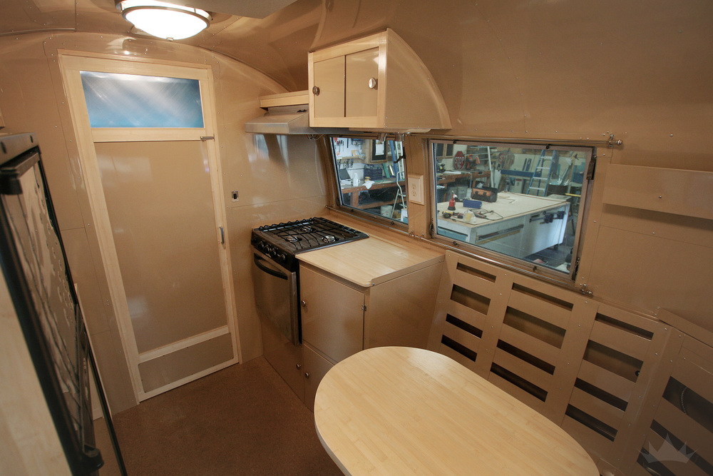 An overview of the interior : A cozy dining space sits beside the pocket-sized kitchen.