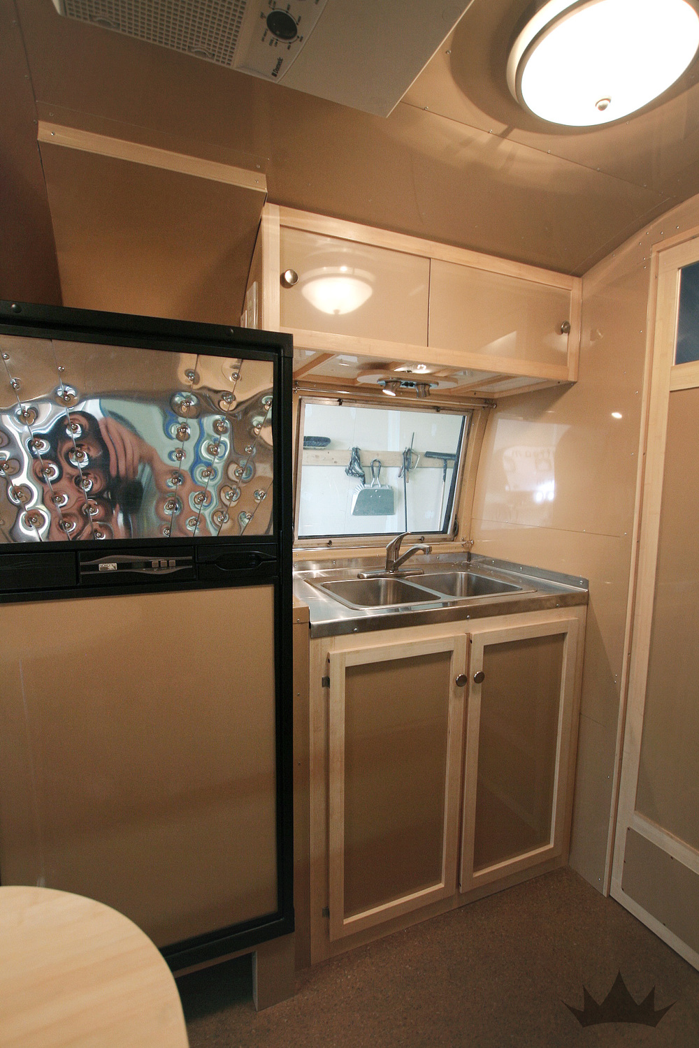 An overview of the interior : A double basin sink and large fridge were masterfully worked in.