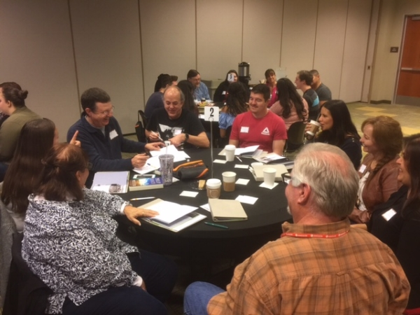 Guests at Next Steps drinking coffee and playing the Get to Know Each Other Game with dice. This is very similar to the opening questions shared when a small group is new. It gives them a taste of community that many times leaves them open or even wanting more.