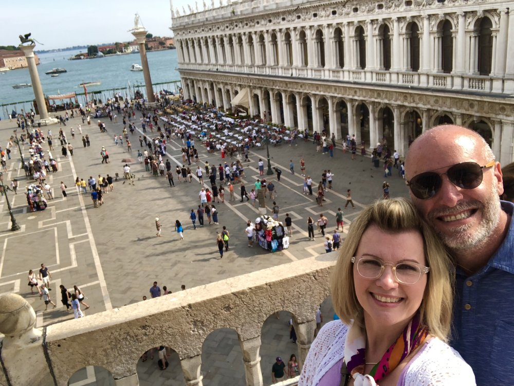 With my wife Michelle standing on a thousand year old balcony in front of Saint Marks Basilica in Saint Mark's Square, Venice.