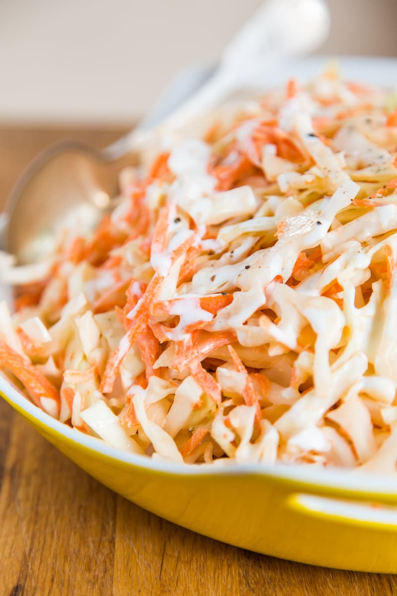 INGREDIENTS   For the slaw:  1 small head (2 to 2 1/2 pounds) cabbage (green, red, or a mix) 2 to 3 large carrots (3 to 3 1/2 cups shredded) 1 tablespoon salt,  optional  1 1/4 cup coleslaw dressing  For the dressing (choose one):   Mayonnaise dressing:  1 cup mayonnaise 1/4 cup white wine vinegar or cider vinegar 1 tablespoon sugar 1/2 teaspoon salt   Buttermilk dressing:  1/2 cup buttermilk 1/2 cup mayonnaise 1/4 cup white wine vinegar or cider vinegar 1 tablespoon sugar 1/2 teaspoon salt   Sour cream dressing:  1/2 cup sour cream 1/2 cup mayonnaise 1/4 cup white wine vinegar or cider vinegar 1 tablespoon sugar 1/2 teaspoon salt  INSTRUCTIONS   Shred the cabbage : Cut the cabbage in half and peel off a few of the thin outer layers. Cut each half into quarters, then cut out the tough core in the middle. Slice each quarter crosswise into thin shreds, or run the quarters through a food processor with a shredding blade. Transfer the shredded cabbage to a large mixing bowl.   Salt the cabbage — OPTIONAL : Salting the cabbage helps it  stay crisp a little longer  if you're making the coleslaw ahead. Transfer the cabbage to colander and toss it with a tablespoon of salt. Let stand on a plate or in the sink for an hour or two. Squeeze as much moisture as you can from the cabbage, then continue making the coleslaw.   Shred the carrots : Peel the carrots, then either cut them into very small matchsticks, or shred them using a food processor with a shredding blade or on a box grater. Transfer the shredded cabbage to the mixing bowl with the cabbage.  Toss the shredded cabbage and carrots together.   Whisk the dressing : Whisk together the ingredients for your dressing in a small bowl. Taste and add more salt, sugar, or vinegar to taste.    Toss the slaw with the dressing : Pour the dressing over the shredded cabbage and carrots. Toss gently to combine, making sure all the shreds are coated evenly. (If you're making this more than an hour or two ahead of your party, save a little dressing to toss with the salad just before serving.)   Refrigerate for at least 1 hour before serving : Coleslaw has the best texture and flavor the day its made, but it still keeps well for several days in the fridge. If you're making this coleslaw more than a day ahead, don't skip the salting step above. For extra creaminess, drizzle a little reserved dressing over the top of the slaw, or fold an extra spoonful of mayo into the slaw just before serving.